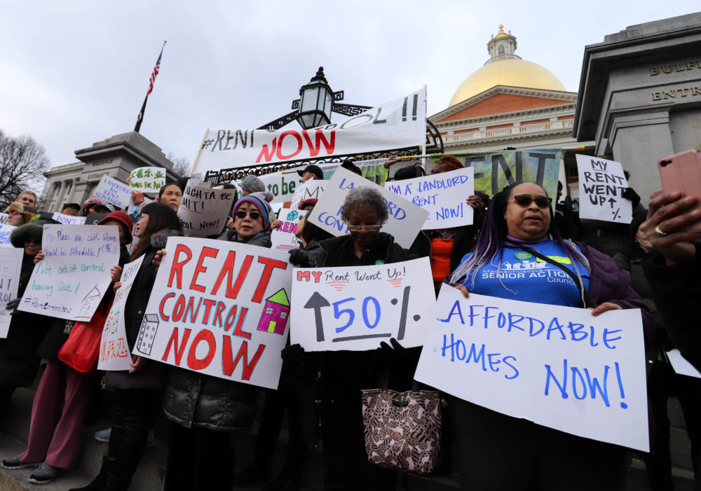 Housing activists swarmed the front steps of the State House on Tuesday before heading back inside to a legislative hearing on rent control. (Sam Doran/SHNS)