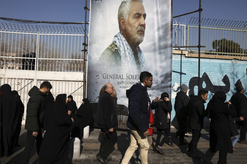 Mourners on Monday walk back from a funeral ceremony for Iranian Gen. Qassem Soleimani in front of the former U.S. Embassy, who was killed with others in Iraq by a Friday U.S. drone attack. (Vahid Salemi/AP)