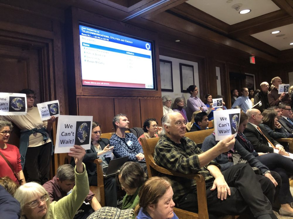 People packed a hearing on carbon pricing at the State House on Tuesday. (Bruce Gellerman/WBUR)