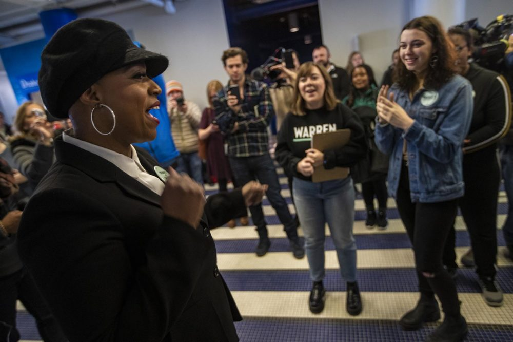 Congresswoman Ayanna Pressley pumps up a group of student canvassers during an an Elizabeth Warren campaign event at the Drake University Student Center in Des Moines, Iowa. (Jesse Costa/WBUR)