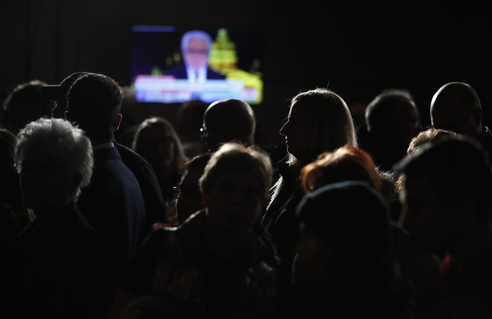People wait for results at a caucus night campaign rally for democratic presidential candidate former Vice President Joe Biden on Monday in Des Moines, Iowa. (John Locher/AP)