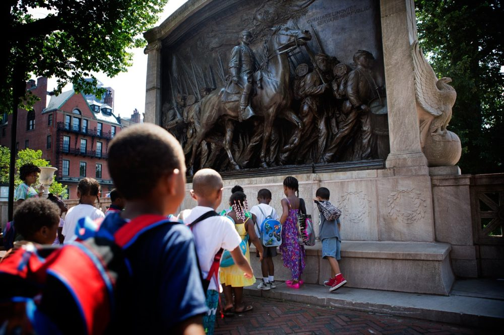 A group of elementary school students from Paige Academy in Roxbury visit the Shaw Memorial at the Boston Common to learn about the 54th Regiment. (Jesse Costa/WBUR)