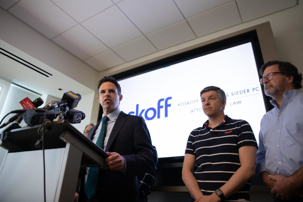 Josh Koskoff, attorney for nine families suing gun manufacturer Remington Arms Co., speaks at a 2019 press conference. Ian Hockley's son and Bill Sherlach's wife were killed in the 2012 Sandy Hook Elementary School Shooting. (Ryan Caron King / Connecticut Public Radio)