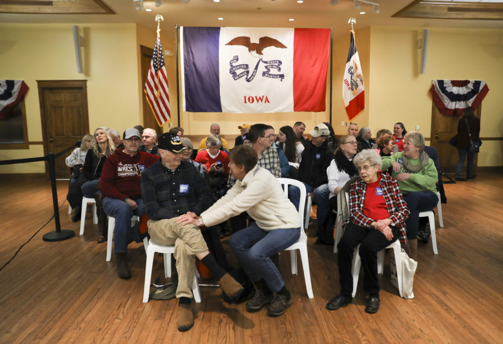 Audience members wait for speakers to begin at a campaign event for Pete Buttigieg at The Music Man Square in Mason City, Iowa, on Wednesday, Jan. 29, 2020. (Rebecca F. Miller for Here & Now)