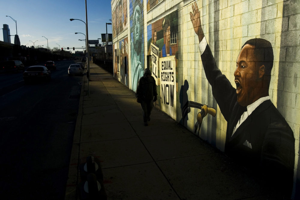 A person walks past a mural of Martin Luther King in Philadelphia, Friday, Jan. 18, 2008. Monday, Jan. 21, 2008 is Martin Luther King Day. (Matt Rourke/AP)