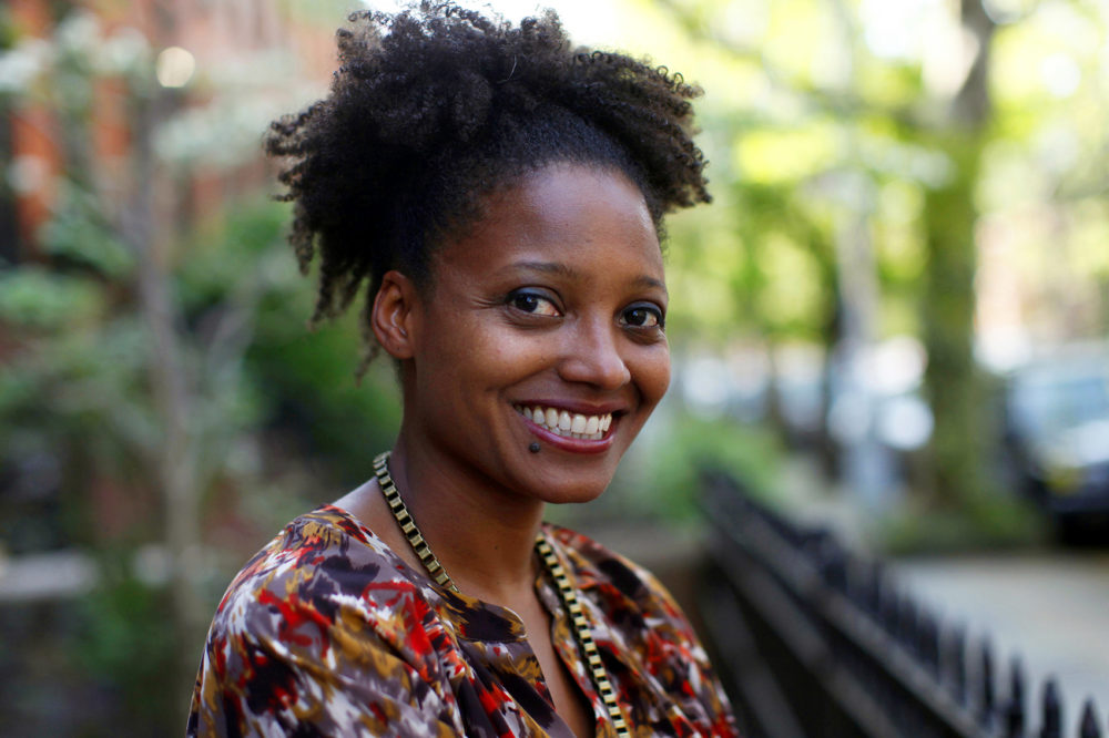 In this April 16, 2012 file photo, Pulitzer Prize winning poet Tracy K. Smith poses outside her apartment in New York. Smith has embarked on the first of several trips to bring her poetry to rural pockets of the country where she says book festivals rarely take her. (Jason DeCrow, File/AP)