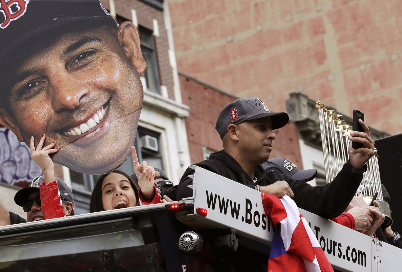 Former Red Sox manager Alex Cora celebrated the team's 2018 World Series championship at a parade in Boston in October of that year. (Charles Krupa/AP)