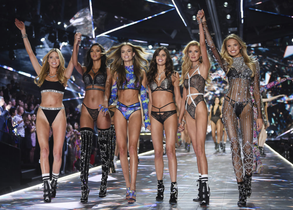 Models walk the runway in the final Victoria's Secret Fashion Show in 2018. (Evan Agostini/AP)