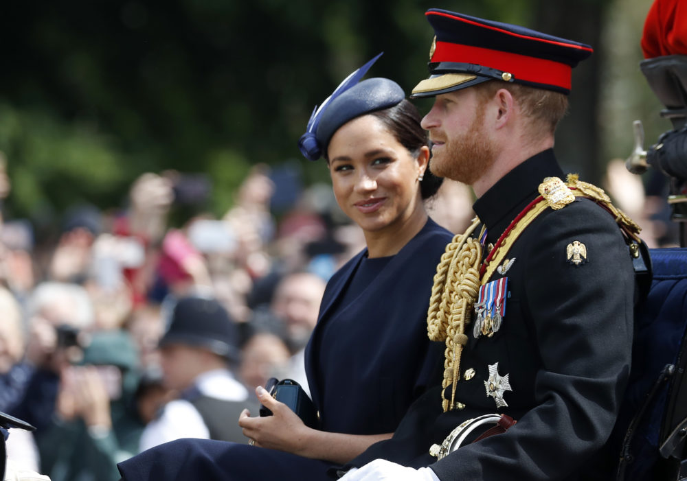 In this Saturday, June 8, 2019 file photo, Britain's Meghan, the Duchess of Sussex and Prince Harry ride in a carriage to attend the annual Trooping the Colour Ceremony in London. (Frank Augstein/AP)