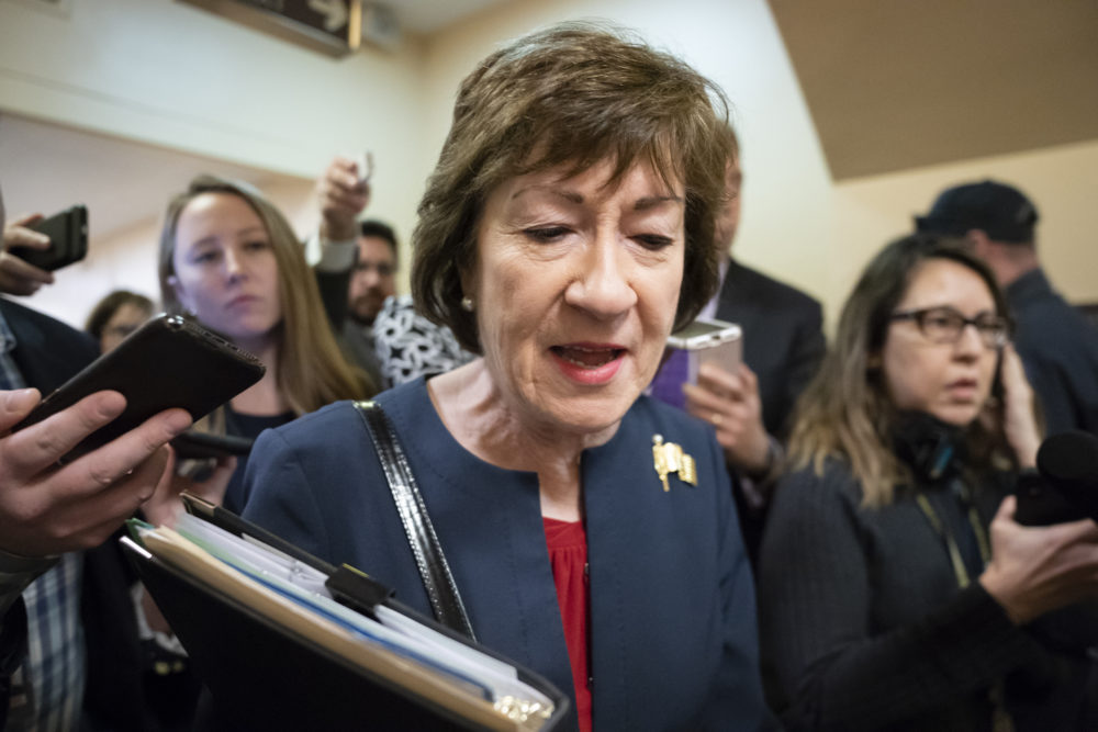 Sen. Susan Collins, R-Maine, is surrounded by reporters as she heads to a vote at the Capitol in Washington, Wednesday, Nov. 6, 2019. (J. Scott Applewhite/AP)