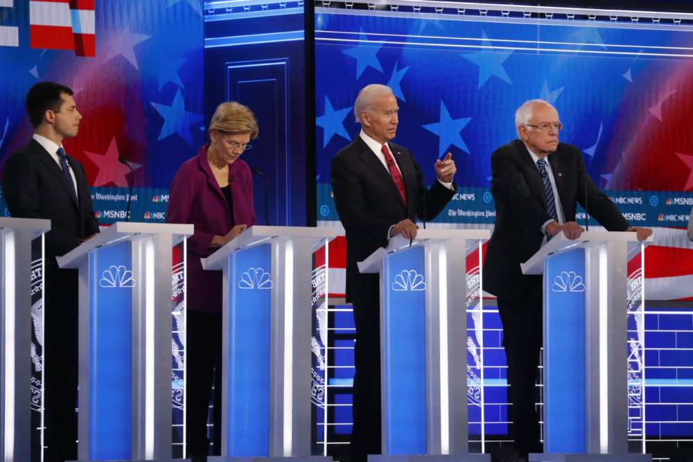 Pete Buttigieg, Elizabeth Warren, Joe Biden and Bernie Sanders are shown on stage during the Nov. 20 Democratic presidential primary debate. The candidates debate again Tuesday along with Amy Klobuchar and Tom Steyer. Wednesday, (John Bazemore/AP)