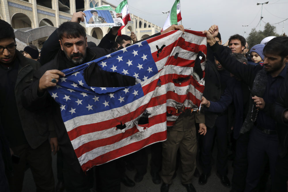 Protesters in Iran burn a U.S. flag during a demonstration over the U.S. airstrike in Iraq that killed Iranian Revolutionary Guard Gen. Qassem Soleimani. (Vahid Salemi/AP)