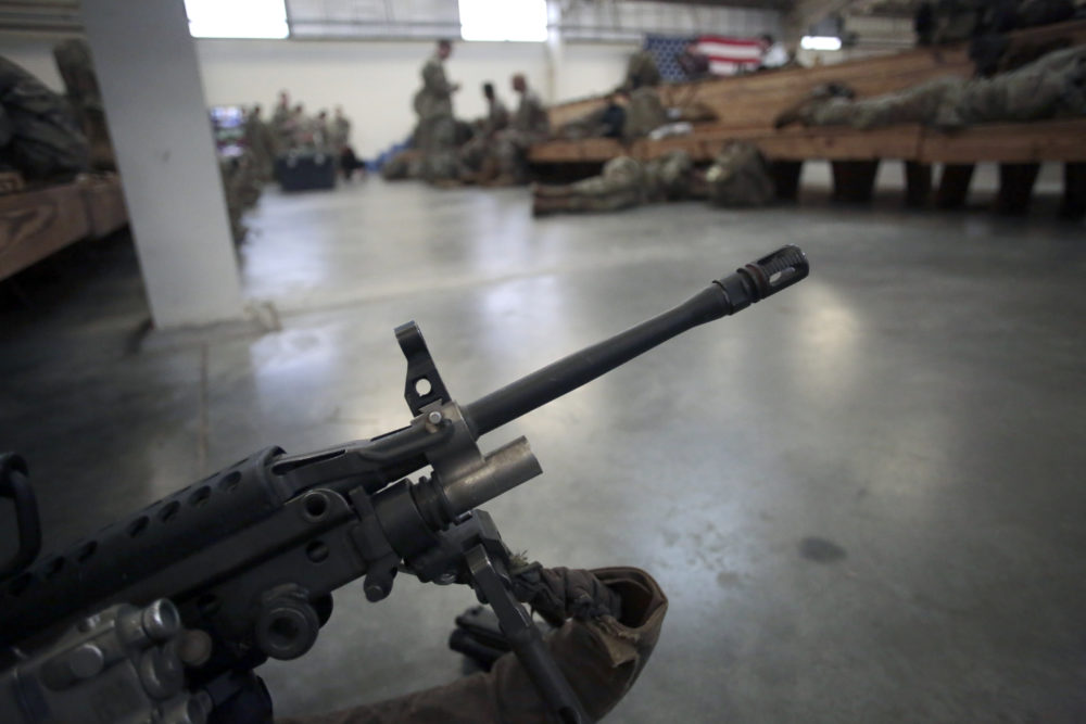 A U.S. Army soldier's weapon is ready to head out Saturday, Jan. 4, 2020 at Fort Bragg, N.C., as troops from the 82nd Airborne are deployed to the Middle East as reinforcements in the volatile aftermath of the killing of Iranian Gen. Qassem Soleimani. (Chris Seward/AP)