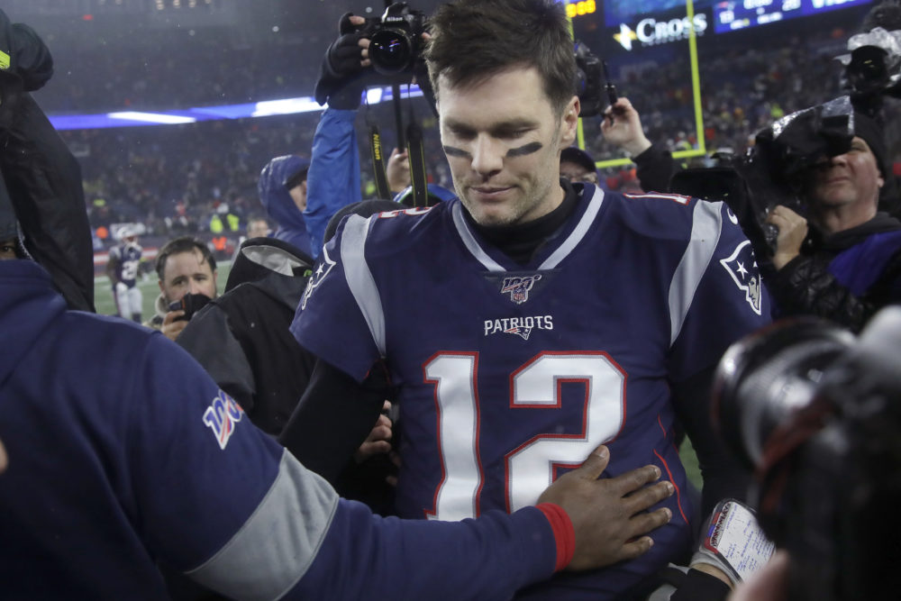 New England Patriots quarterback Tom Brady leaves the field after losing to the Tennessee Titans in an NFL wild-card playoff football game Saturday. (Elise Amendola/AP)