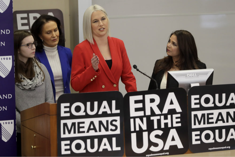 Vice President of Equal Means Equal Natalie White, center right, faces reporters as plaintiff Katherine Weitbrecht, left, legal counsel Wendy Murphy, second from left, and President of the organization Kamala Lopez, right, look on during a news conference, Tuesday, in Boston, (Steven Senne/AP)