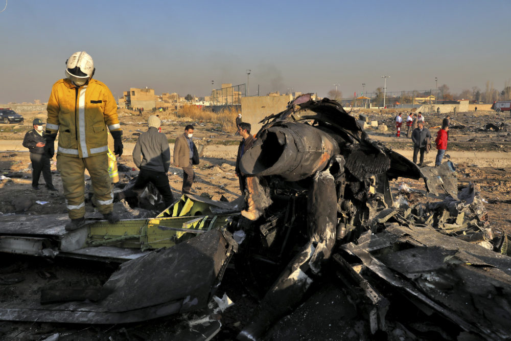 Rescue workers search the scene where a Ukrainian plane crashed in Shahedshahr, southwest of the Iranian capital, Wednesday. (Ebrahim Noroozi/AP)