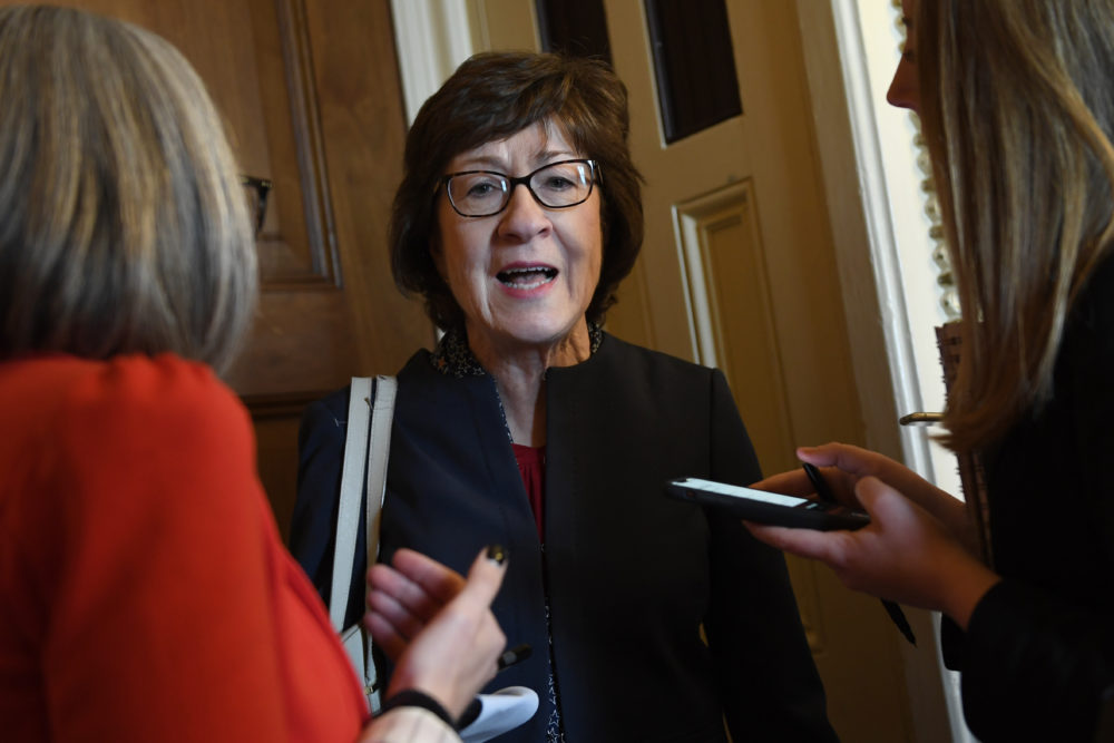In this Jan. 15, 2020, photo, Sen. Susan Collins, R-Maine, talks to reporters on Capitol Hill in Washington. In the dawn of what may be her toughest reelection fight, veteran Collins has parachuted into familiar terrain -- the pressure-packed middle of an issue, this time the impeachment of President Donald Trump. (Susan Walsh/AP)