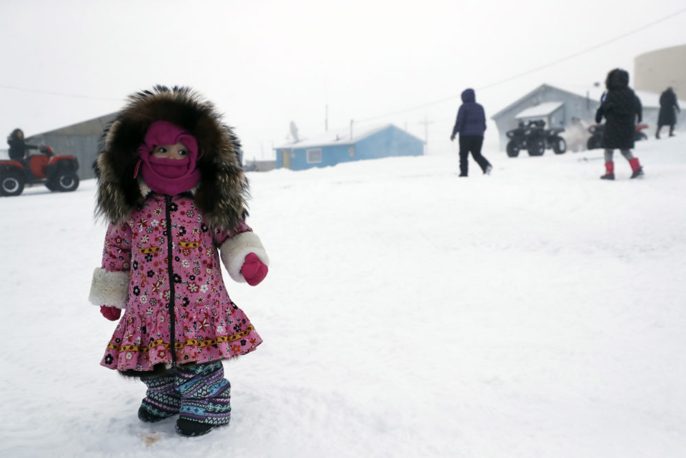 A girl waits for her mother on Jan. 19 in Toksook Bay, Alaska. The first Americans to be counted in the 2020 census starting Tuesday live in this Bering Sea coastal village. (Gregory Bull/AP)