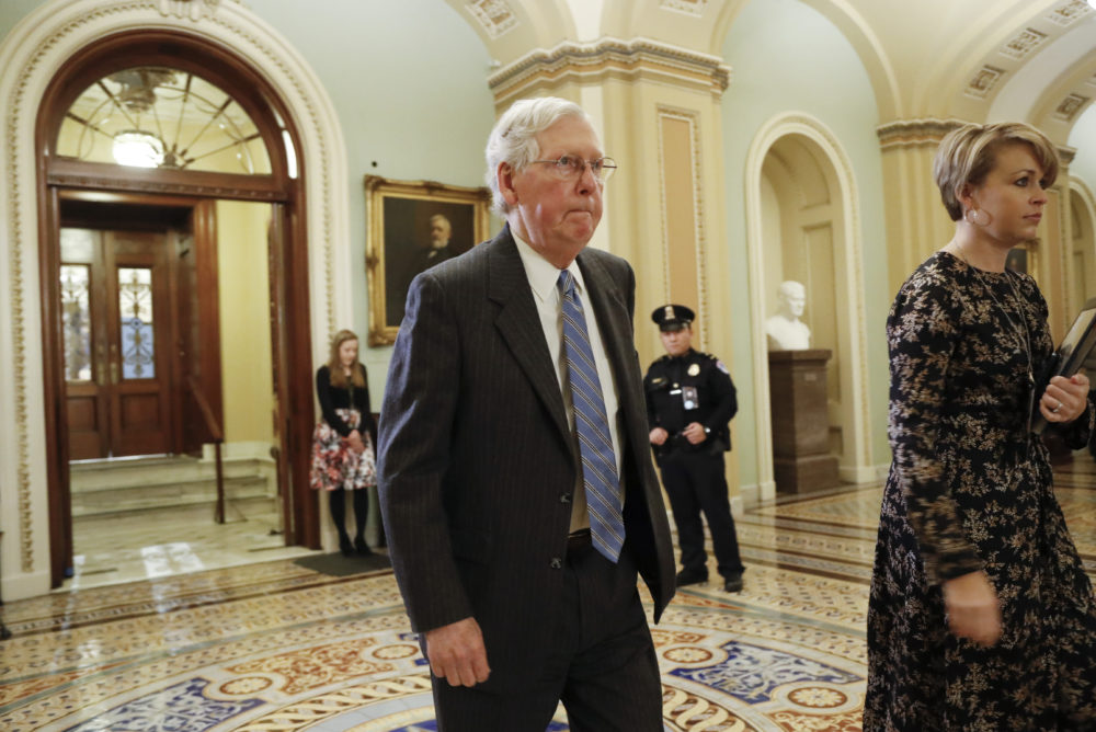 Senate Majority Leader Mitch McConnell walks outside the Senate chamber at the Capitol in Washington during a break in the impeachment trial of President Donald Trump on Jan. 24, 2020. (Julio Cortez/AP)