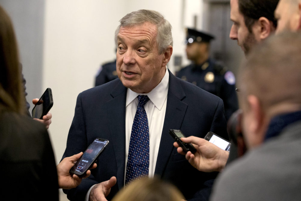 Sen. Dick Durbin talks to reporters as he walks to attend the impeachment trial of President Trump. (Jose Luis Magana/AP)