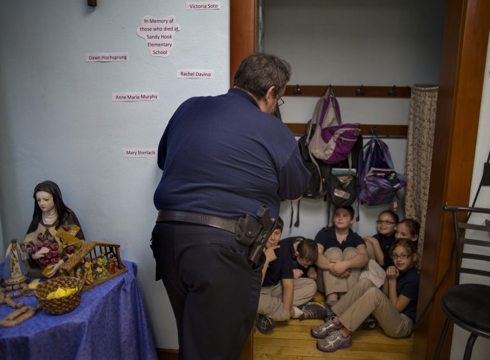 In this file photo of Jan. 14, 2013, police Chief Scott Robertson talks with 4th  grade students as they huddle in closet a during a lockdown drill at the St. Bernard School in New Washington, Ohio, a month after the Sandy Hook Elementary School massacre in Newtown, Conn. (Craig Ruttle/AP)