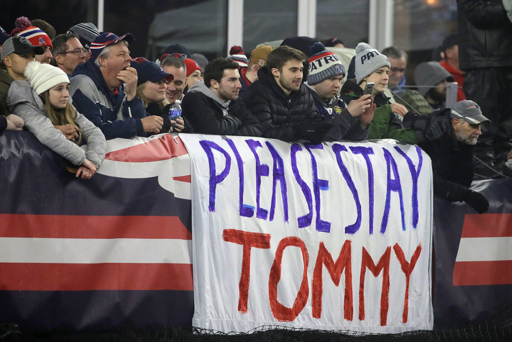 New England Patriots fans stand by a sign supporting quarterback Tom Brady in the first half of an NFL wild-card playoff football game between the Patriots and the Tennessee Titans, Saturday, Jan. 4, 2020, in Foxborough, Mass. Brady's contract expires at the end of the season. (Elise Amendola/AP Photo)