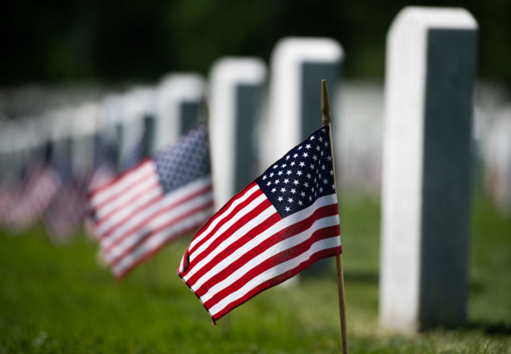 U,S. flags are planted at grave sites at Arlington National Cemetery in Arlington, Virginia, ahead of the Memorial Day weekend in 2019. (Saul Loeb/AFP/Getty Images)