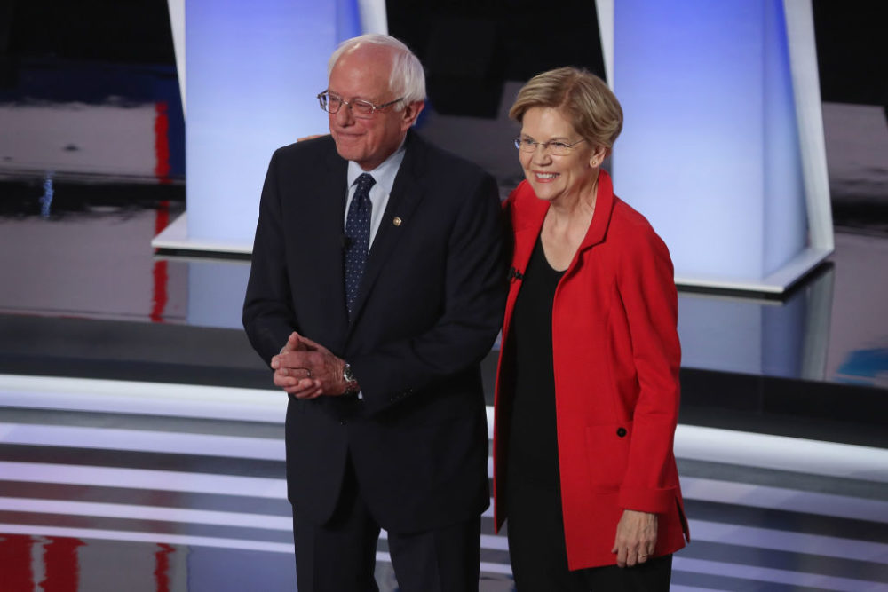 Democratic presidential candidates Sen. Bernie Sanders and Sen. Elizabeth Warren take the stage at the beginning of the Democratic Presidential Debate in Detroit, Michigan. (Justin Sullivan/Getty Images)