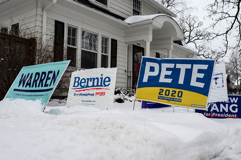 Signs for a number of different candidates are staked in the lawn outside of a home in Des Moines, Iowa, on January 25, 2020. - With nine days to go candidates vying for the Democratic presidential nomination are making their final push in Iowa before the caucuses on February 3, 2020. (STEPHEN MATUREN/AFP via Getty Images)