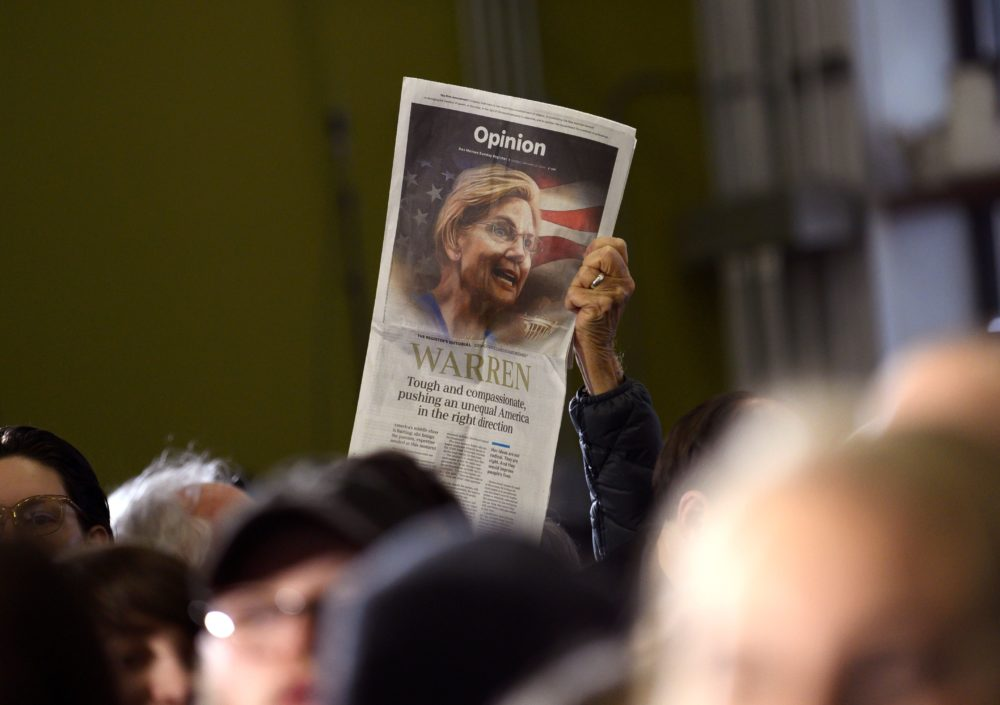An event attendee holds up a copy of the Des Moines Register newspaper's Opinion page endorsement of Democratic presidential candidate  Elizabeth Warren during a campaign stop in Cedar Rapids, Iowa on Jan. 26, 2020. (Photo by Stephen Maturen /AFP via Getty Images)