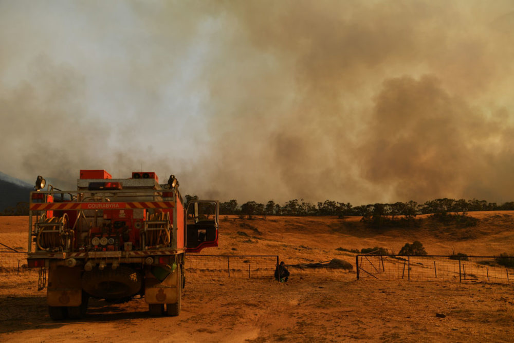 A Rural Fire Service firefighter views a flank of a fire on January 11, 2020 in Tumburumba, Australia. (Sam Mooy/Getty Images)