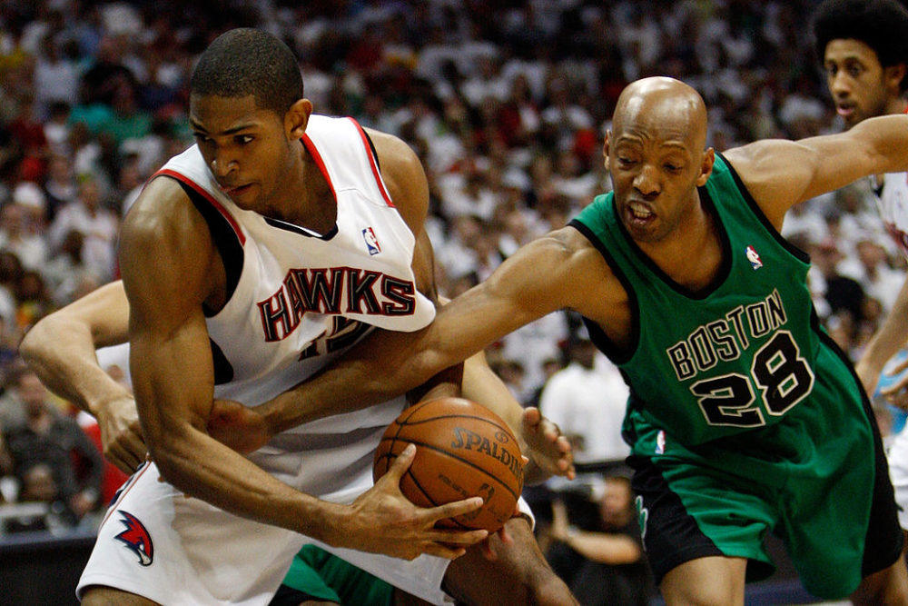 Al Horford is fouled by Sam Cassell of the Boston Celtics in the 2008 Eastern Conference Quarterfinals. (Chris Graythen/Getty Images)