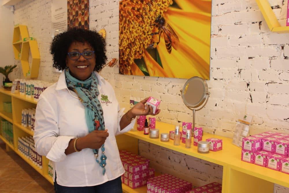 "Ivy Lawson in her store, Ivyees ""Everything Honey."" (Paris Alston/WBUR)"