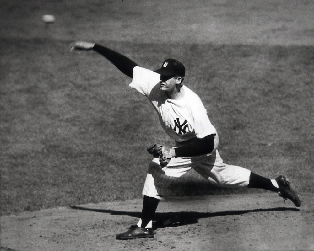 Yankees pitcher Don Larsen throws against the Brooklyn Dodgers, en route to a perfect game in Game 5 of the 1956 World Series.  (AP)