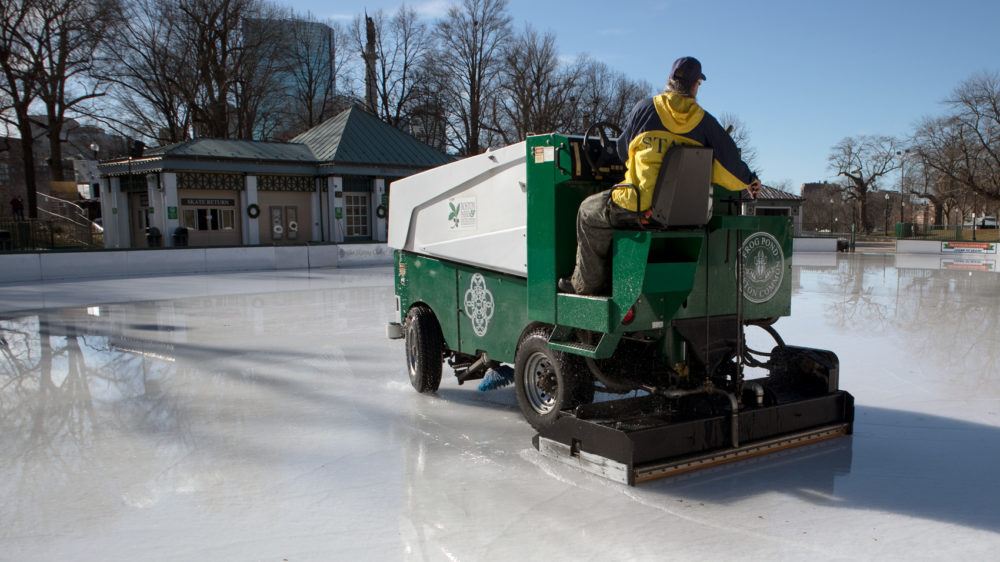 With temperatures climbing above 70 degrees on Sunday, the Frog Pond ice became a large puddle. (Adrian Ma/WBUR)