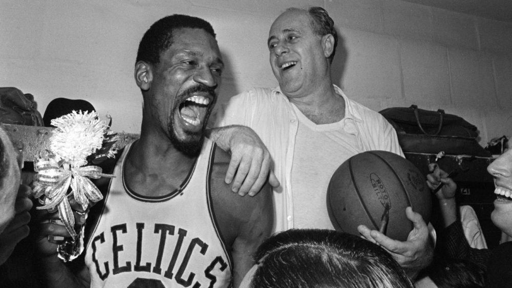 Bill Russell, left, and Celtics coach Red Auerbach celebrate the team's victory over the L.A. Lakers for the 1966 NBA title. (AP)