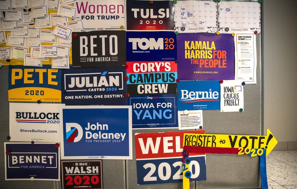 Presidential campaign signs on the wall in the Drake University Student Center. in Des Moines, IA. (Jesse Costa/WBUR)