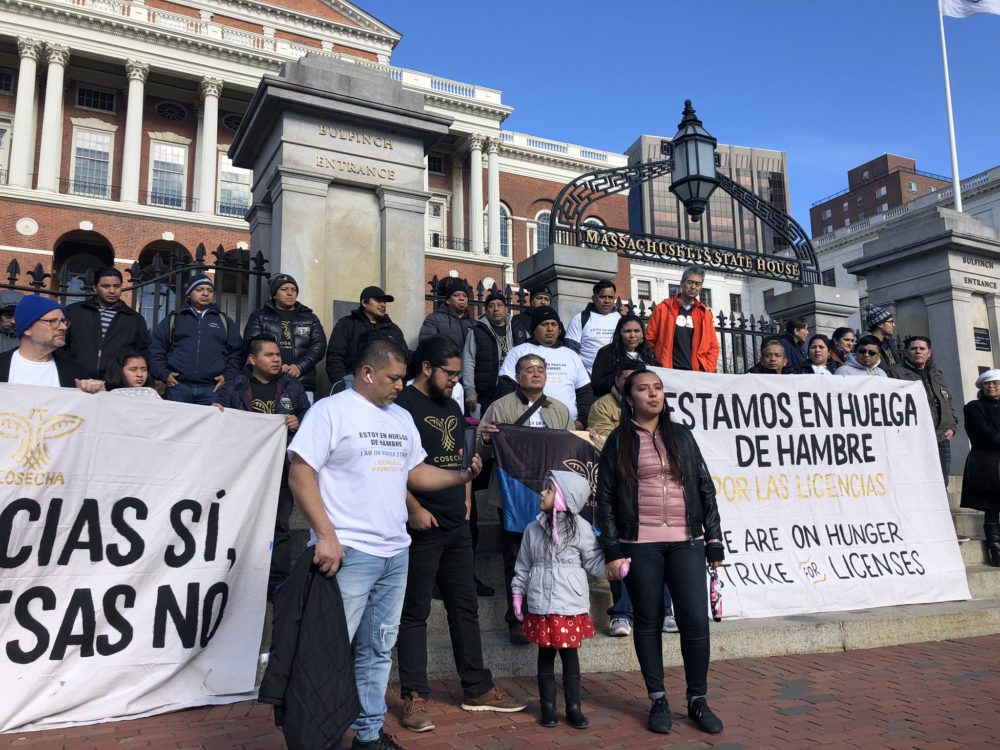 Activists gather outside the Massachusetts State House on Monday to launch a hunger strike in support of a bill that would allow driver's licenses for undocumented immigrants. (Shannon Dooling/WBUR)