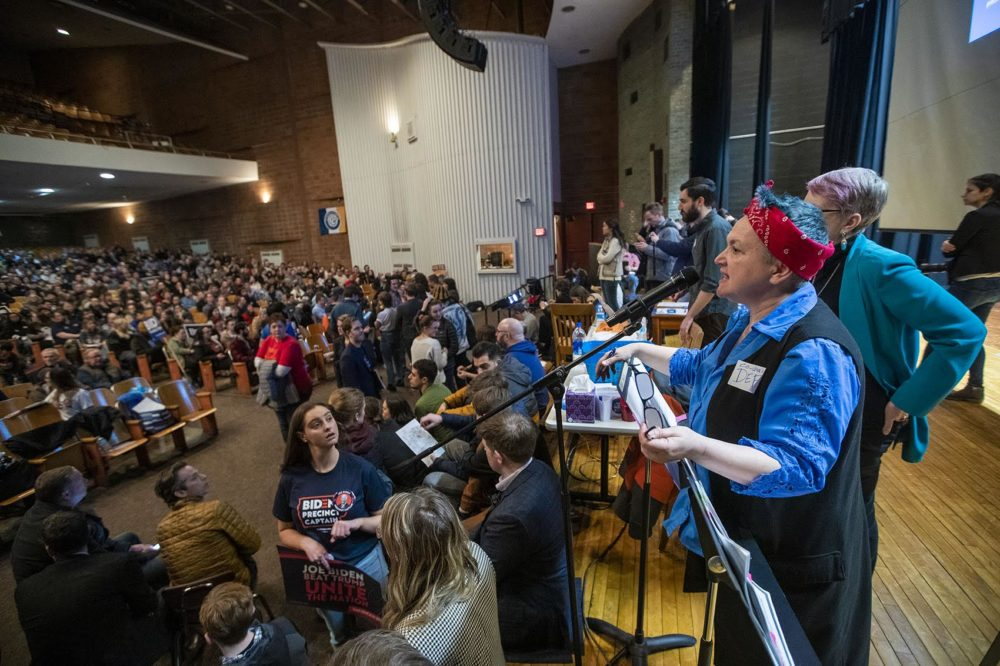 Co-chair of the caucus at Central Campus High School Deb Copeleand attempts to bring the room to order. (Jesse Costa/WBUR)