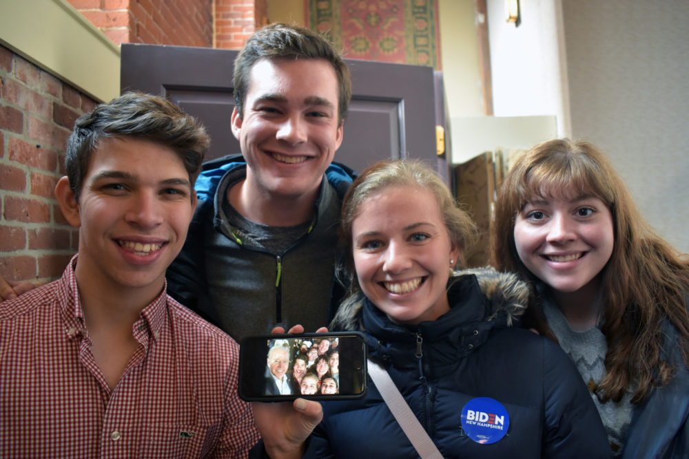 A group of students from Principia College in Elsah, Illinois, show the selfie they took with Joe Biden. The students are part of a special program called Race for the White House where they travel to campaign stops and rallies in Iowa and New Hampshire (among other places) to learn about the process. From left is Hunter Hummell, Will Adler, Chrissy Fredrikson and Sarah Geis. (Meghan B. Kelly/WBUR)