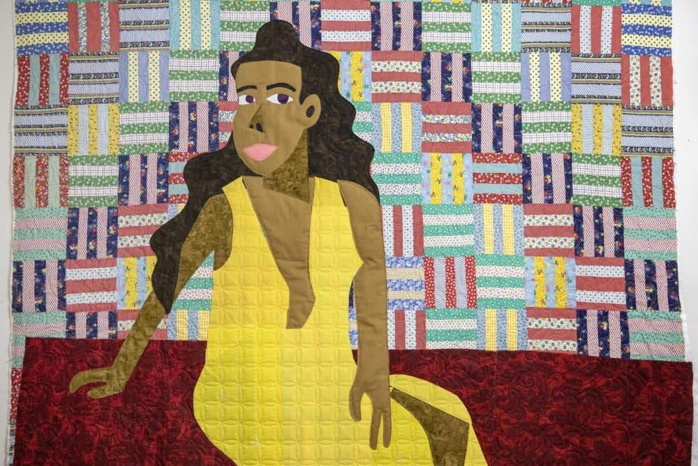 A portrait of the artist's sister, Latoya Anderson by quilt artist Michael Thorpe. (Robin Lubbock/WBUR)