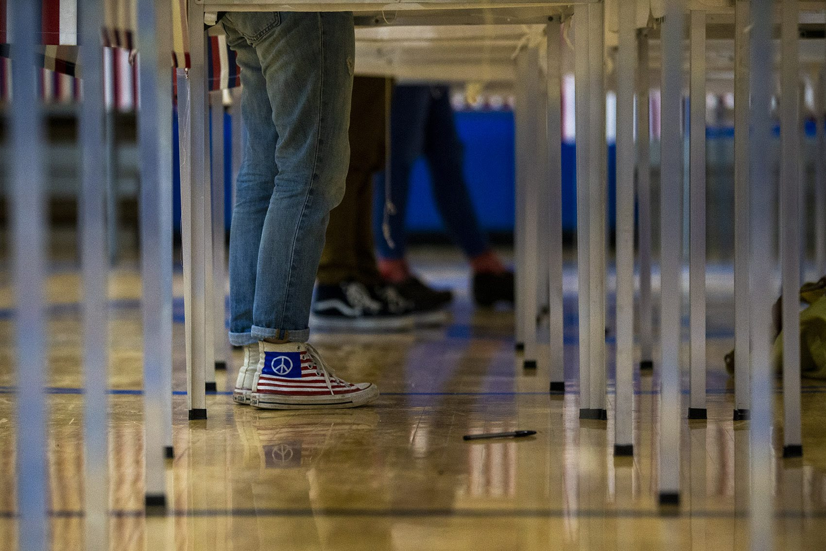 A University of New Hampshire student votes at the polls at Oyster River High School in Durham, N.H. (Jesse Costa/WBUR)