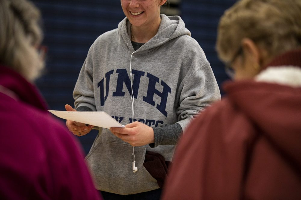 A UNH student recieves her ballot at the polls at Oyster River High School in Durham, N.H. (Jesse Costa/WBUR)