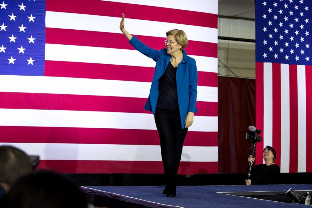 Sen. Elizabeth Warren walks on stage to address a crowd of supporters the night of the New Hampshire primary. (Robin Lubbock/WBUR)