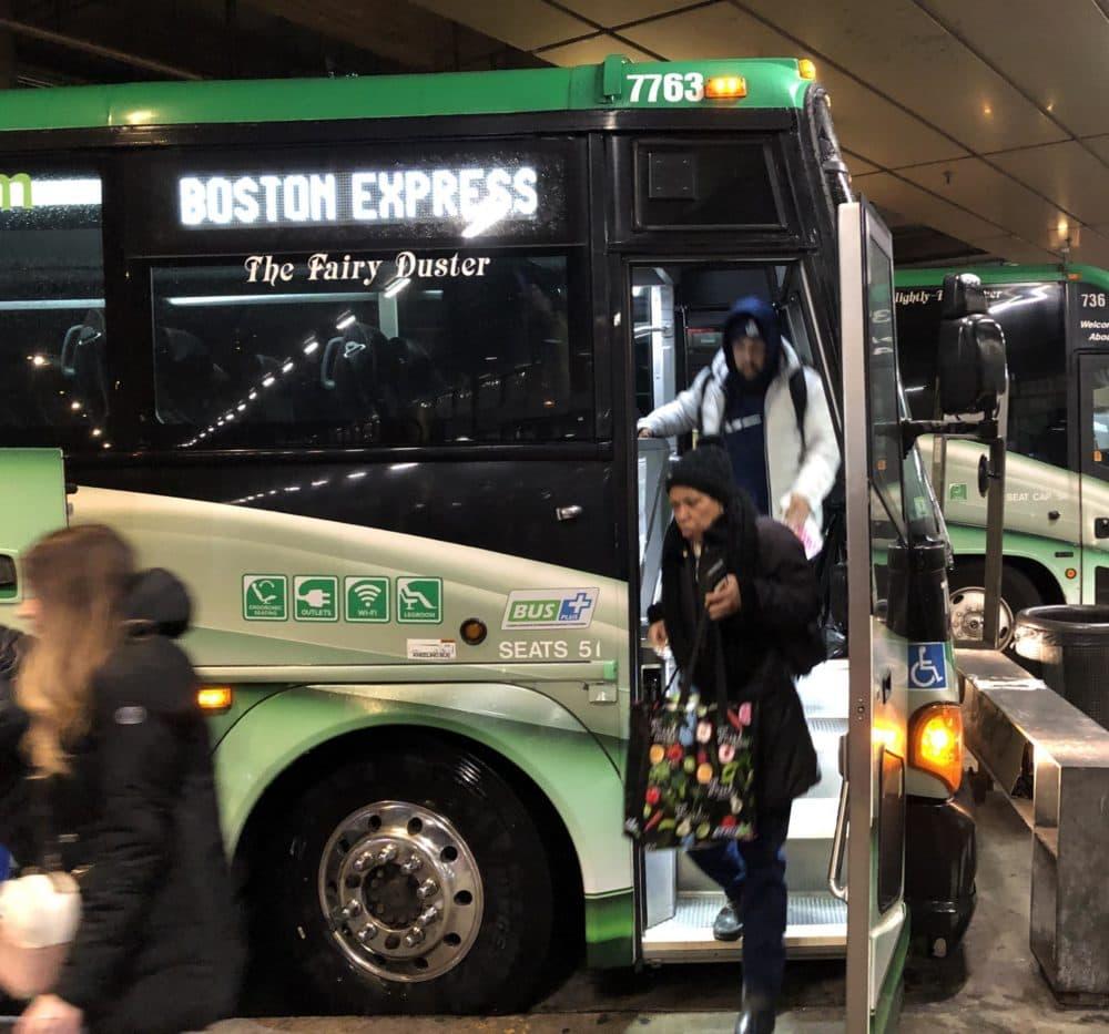 Passengers disembarking from a Peter Pan bus in Boston, Massachusetts, on Feb. 10, 2020. (Alden Bourne/NEPR)