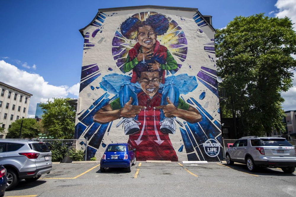 "This June 2019 photo features the mural, ""Breathe Life,"" by the artist Problak Gibbs at 808 Tremont Street in Roxbury. (Jesse Costa/WBUR)"