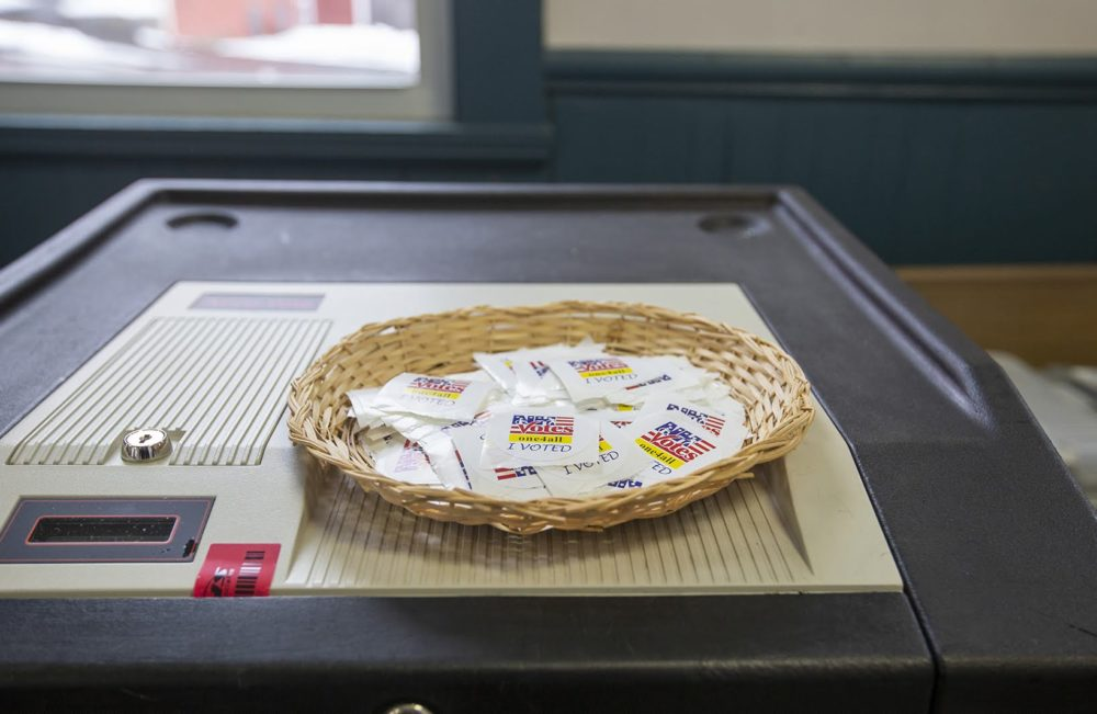 Stickers on top of a voting machine at a polling place in Concord, New Hampshire.  (Joe Difazio for WBUR)