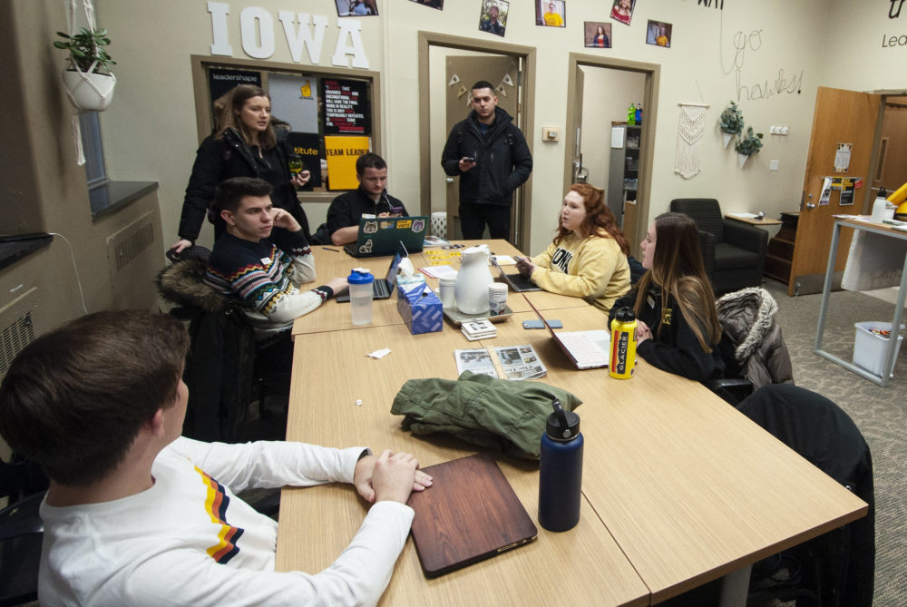 Members of Hawk the Vote, a nonpartisan group to increase youth turnout in the 2020 elections and Iowa caucuses at the University of Iowa hold a Q&A session about the upcoming caucuses in Iowa City. (Chris Bentley/Here & Now)