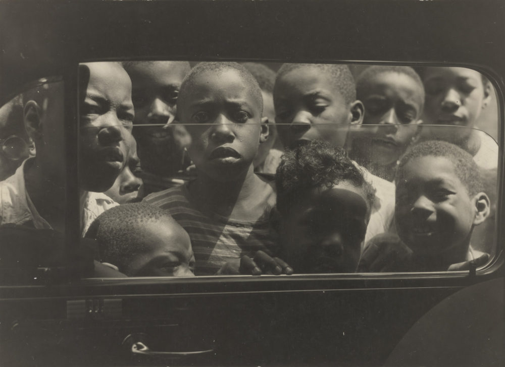 "Gordon Parks, ""Boys Looking in Car Window, Harlem,"" August 1943. (Courtesy of and copyright The Gordon Parks Foundation)"