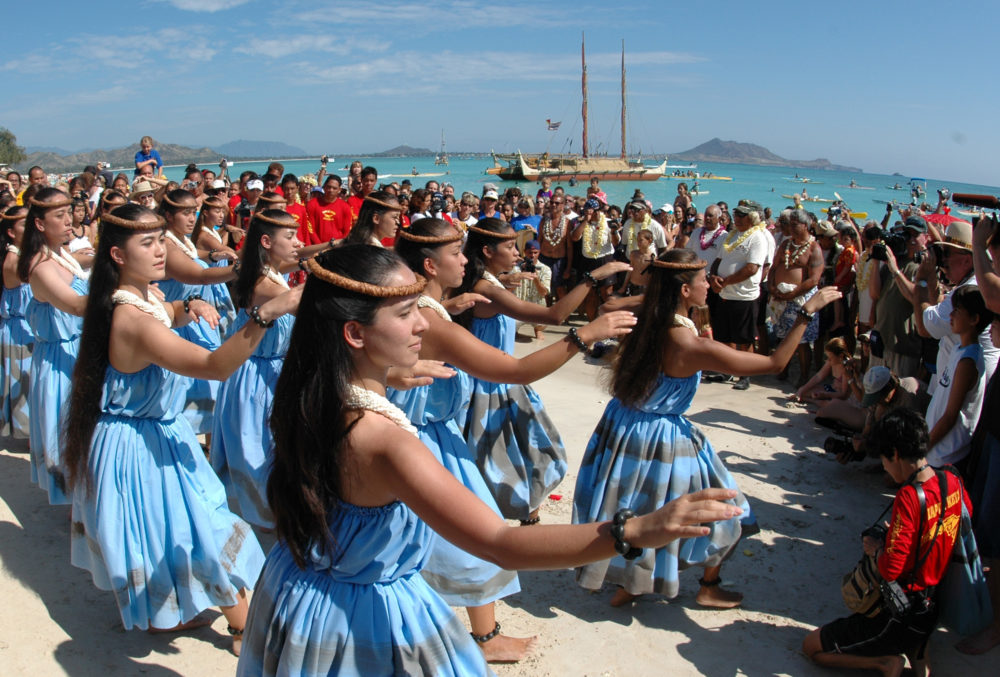 Hula dancers welcome the sailing crew into Kailua Bay in Kailua, Hawaii. (Ronen Zilberman/AP)